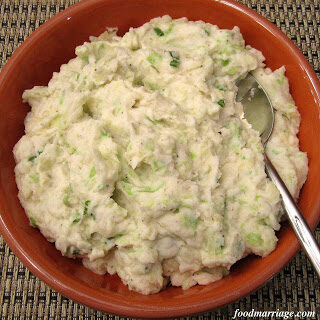 Colcannon - Irish Mashed Potatoes and Cabbage - in an orange bowl.