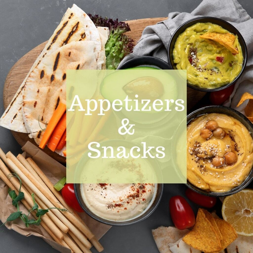 A variety of dips including hummus and guacamole. Served with breadsticks, pita, bread, carrot sticks, and avocado.